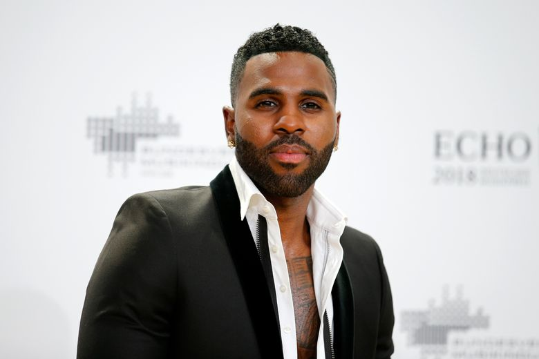 """FILE – In this April 12, 2018 file photo, singer Jason Derulo poses during a photocall upon arrival for the 2018 Echo Music Awards in Berlin. In """"Let's Shut Up & Dance,"""" the R&B singer collaborates with Asian K-pop acts Lay Zhang and NCT 127 in a trans-Pacific partnership he thinks ought to be increasingly common in the musical future. (Axel Schmidt/Pool Photo via AP)"""