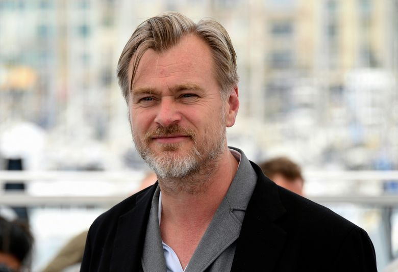 """FILE – In this May 12, 2018 file photo, director Christopher Nolan poses for photographers during a photo call for """"Rendezvous with Christopher Nolan"""" at the 71st international film festival, Cannes, southern France. Batman is turning 80 this year, and Christopher Nolan's """"Dark Knight"""" trilogy is coming back to select theaters to celebrate in 70MM IMAX. Warner Bros. president of domestic distribution Jeff Goldstein said Tuesday that the engagement will kick off in Los Angeles at Universal CityWalk on March 30 with back-to-back screenings of """"Batman Begins,"""" """"The Dark Knight"""" and """"The Dark Knight Rises."""" Nolan will participate in a Q&A between the second and third films. (Photo by Arthur Mola/Invision/AP, File)"""