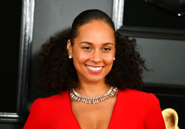 """FILE – This Feb. 10, 2019 file photo shows Alicia Keys at the 61st annual Grammy Awards in Los Angeles. Keys has a memoir coming out in November, to be published by Oprah Winfrey's imprint. Flatiron Books announced Wednesday, March 13, that Keys' """"More Myself"""" will be released Nov. 5 through Winfrey's """"An Oprah Book"""" imprint. (Photo by Jordan Strauss/Invision/AP, File)"""