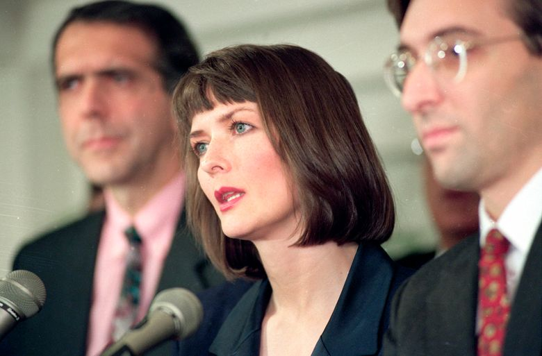 """FILE – In this Dec. 10, 1992 file photo, flanked by her attorneys Frank Morocco, left, and Sheldon T. Zenner, right, Lawrencia Bembenek answers questions at a new conference in Chicago, Ill. The attorney for Wisconsin's famous runaway convict and convicted murderer Laurie """"Bambi"""" Bembenek is asking Gov. Tony Evers for a pardon. Bembenek insisted up until her death in 2010 that she did not kill the ex-wife of her husband in 1982. Her attorney filed a pardon request with Evers earlier this year. Bembenek, a former Milwaukee Police officer who escaped from prison after she was convicted of murder in a wild criminal saga that later became a TV miniseries. (AP Photo/Mark Elias, File)"""