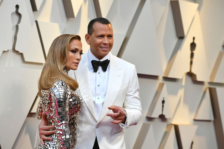 FILe – In this Feb. 24, 2019 file photo, Jennifer Lopez, left, and Alex Rodriguez arrive at the Oscars  at the Dolby Theatre in Los Angeles.  Barack Obama is feeling the love about the engagement of Lopez and Rodriguez. A-Rod on Thursday, March 22, 2019 on Twitter shared a handwritten note that he received in which the former president and his wife, Michelle, congratulated the couple. (Photo by Jordan Strauss/Invision/AP, File)