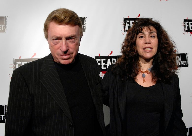 """File-This Oct. 30, 2006, file photo shows writer, director Larry Cohen, left, and wife Cynthia Cohen arriving for the Comcast, Sony and Lionsgate launch party for FEARnet, a multi-platform network dedicated to horror, held at the Boulevard 3 nightclub in Los Angeles.  Cohen, the maverick B-movie director of cult horror films """"It's Alive"""" and """"God Told Me To,"""" has died. He was 77. Cohen's friend and spokesman, the actor Shade Rupe, said Cohen passed away Saturday, March 23, 2019, in Los Angeles surrounded by loved ones. (AP Photo/Phil McCarten, File)"""
