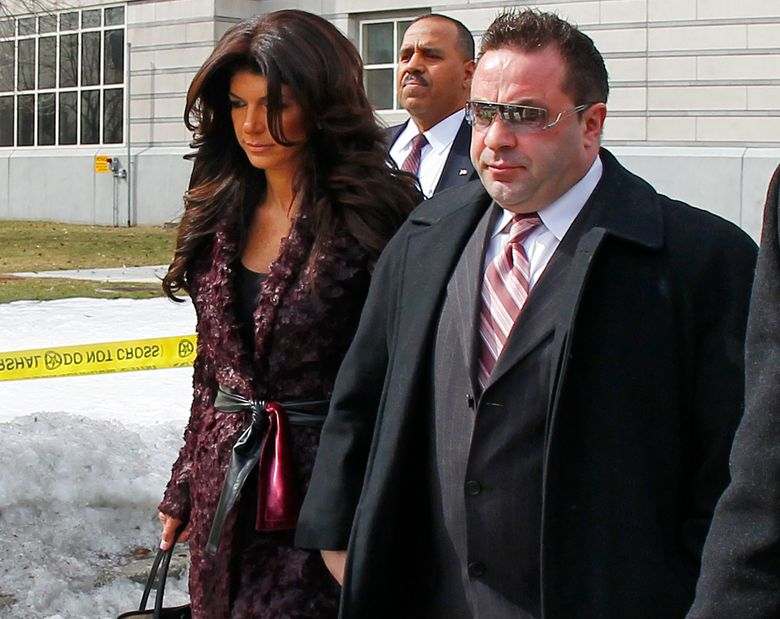 """FILE – This March 4, 2014 file photo shows Teresa, left, and Joe Giudice, from """"The Real Housewives of New Jersey,"""" leaving federal court in Newark, N.J. Joe Giudice has been released from federal prison and is waiting to see if he'll be deported back to Italy. Giudice and wife Teresa pleaded guilty in 2014 to bankruptcy fraud and submitting false loan applications to get $5 million in mortgages and construction loans. Joe Giudice also pleaded guilty to not paying about $200,000 in income taxes. He has said through his attorneys that he came to the U.S. as an infant and wasn't aware he wasn't an American citizen. (AP Photo/Rich Schultz, File)"""