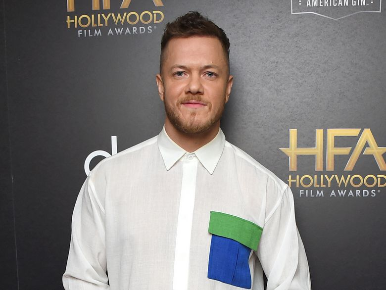 """FILE – In this Nov. 4, 2018 file photo, Dan Reynolds, of Imagine Dragons, winner of the award for Hollywood documentary for """"Believer,"""" poses in the press room at the Hollywood Film Awards in Beverly Hills, Calif. Reynolds posted a lengthy note on Instagram two weeks ago, calling out bands like Slipknot, the 1975 and Foster the People for taking shots at Imagine Dragons. Reynolds says, """"It's just, to me, counterproductive to all of us as artists to engage in menial, self-indulgent conversation."""" (Photo by Jordan Strauss/Invision/AP, File)"""
