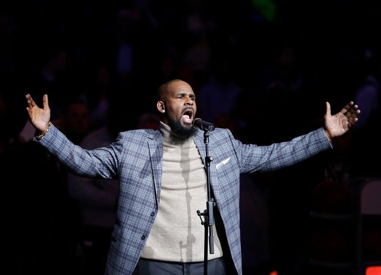 """FILE – In this Nov. 17, 2015, file photo, musical artist R. Kelly performs the national anthem before an NBA basketball game between the Brooklyn Nets and the Atlanta Hawks in New York. An aunt who introduced her underage niece to Kelly and suspects abuse hoped in the six-part """"Surviving R. Kelly"""" docuseries on Lifetime that the embattled star would propel the teen's music career. She alleges the girl wound up on a sex tape instead.  (AP Photo/Frank Franklin II, File)"""