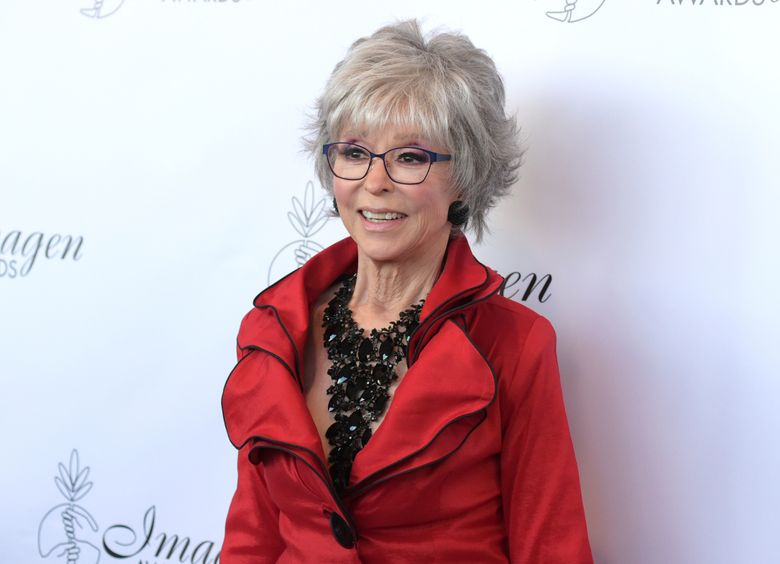 """FILE – In this Aug. 25, 2018, file photo, Rita Moreno arrives at the 33rd annual Imagen Awards in Los Angeles. The Peabody Awards on Thursday announced it will honor the actress, singer and dancer with the career achievement award. That means the 87-year-old will join a handful of people who have achieved """"PEGOT"""" status by winning a Peabody, Emmy, Grammy, Oscar and Tony award. Moreno will be honored at the Peabody's annual gala in New York City on May 18. (Photo by Richard Shotwell/Invision/AP, File)"""