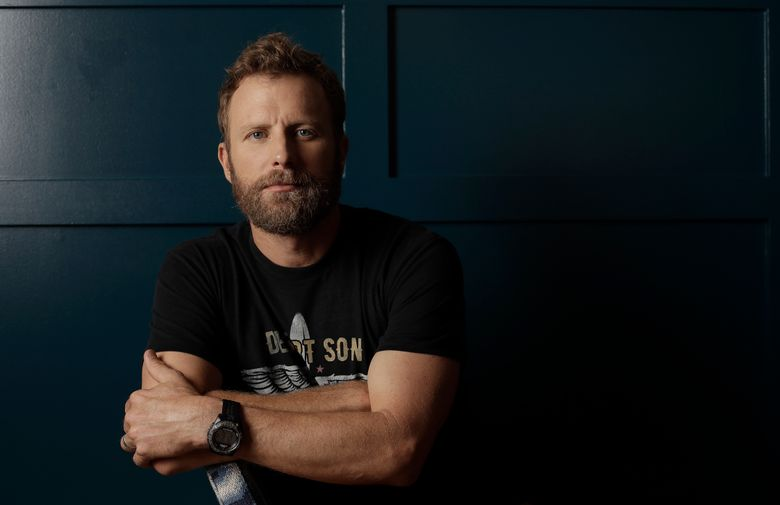 FILE  – In this May 7, 2018, file photo, country music star Dierks Bentley poses in Nashville, Tenn. Bentley said he learned a lot about the music festival business after investing in and curating his first festival, the Seven Peaks Festival, in Bueno Vista, Colo. last year. (AP Photo/Mark Humphrey, File)