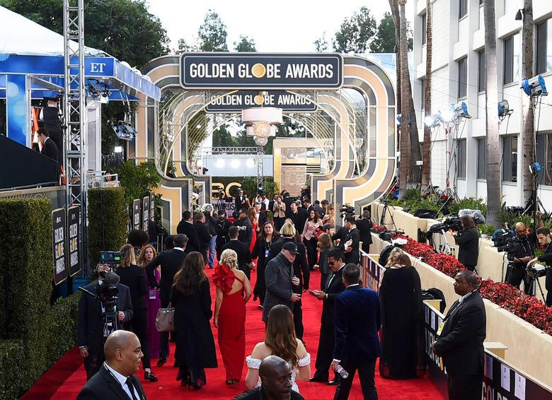 FILE – This Jan. 6, 2019 file photo shows members of the media on the red carpet prior to the 76th annual Golden Globe Awards  in Beverly Hills, Calif. The Hollywood Foreign Press Association (HFPA), dick clark productions (dcp) and NBC will present the 77th Annual Golden Globe Awards on Jan. 5, 2020. (Photo by Jordan Strauss/Invision/AP, File)