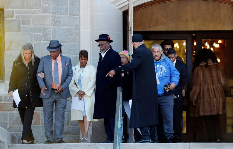"""Family members of the late Aretha Franklin gather before entering the Mausoleum Chapel at the Woodlawn Cemetery, Monday, March 25, 2019, in Detroit. Family celebrated Franklin and other passed family members with a memorial service inside a chapel at the cemetery on what would have been the Queen of Soul's 77th birthday. Franklin died last year after battling pancreatic cancer.  Sabrina Owens, Franklin's niece, says """"our family thought it might be a good idea for us to start the day the right way _ in prayer."""" (AP Photo/Carlos Osorio)"""