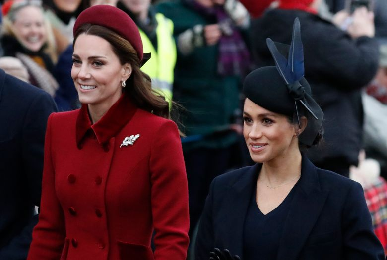 FILE – In this Tuesday, Dec. 25, 2018 file photo, Britain's Kate, Duchess of Cambridge, left, and Meghan, Duchess of Sussex arrive to attend the Christmas day service at St Mary Magdalene Church in Sandringham in Norfolk, England. Britain's royal family is warning that it will block trolls posting offensive messages on its social media channels _ and may report offenders to the police. Buckingham Palace, Clarence House and Kensington Palace issued new guidelines on Monday, March 4, 2019 spelling out the policy banning offensive, hateful and racist language.(AP Photo/Frank Augstein, File)
