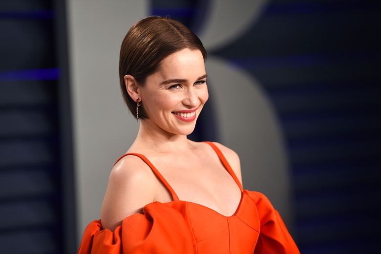 FILE – This Feb. 24, 2019 file photo, Emilia Clarke arrives at the Vanity Fair Oscar Party in Beverly Hills, Calif. Clarke has revealed she's had two life-threatening aneurysms, and two brain surgeries, since the show began. In a first-person story Thursday in The New Yorker, Clarke said she had been healthy all her life when had the first brain aneurysm in 2011 at age 24 while working out at a London gym. (Photo by Evan Agostini/Invision/AP, File)