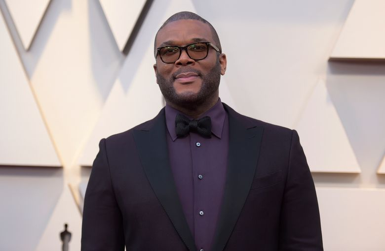 FILE – In this Feb. 24, 2019 file photo, Tyler Perry arrives at the Oscars at the Dolby Theatre in Los Angeles.  Less than a day after the family of a slain single mother of four launched a fundraising appeal, Perry has lent his support.  News outlets report Perry offered to take care of the family's rent to stave off eviction, arrange for 45-year-old Tynesha Evans' body to be flown to Wisconsin for burial and cover her 18-year-old daughter's tuition at Spelman College so she doesn't have to drop out.(Photo by Richard Shotwell/Invision/AP, File)