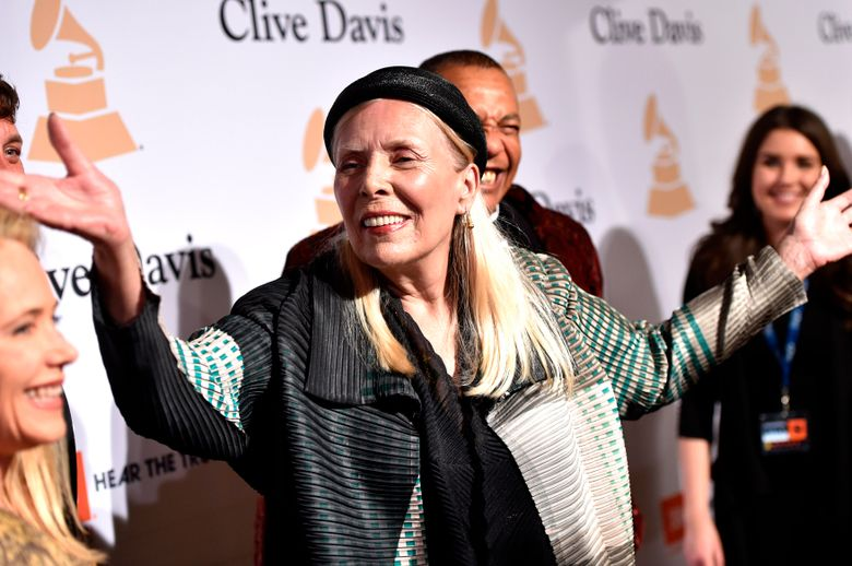 """FILE – In this Feb. 7, 2015 file photo, Joni Mitchell arrives at the 2015 Clive Davis Pre-Grammy Gala in Beverly Hills, Calif. Mitchell's """"Morning Glory On the Vine: Early Songs and Drawings,"""" will be published Oct. 22, 2019. (Photo by John Shearer/Invision/AP, File)"""