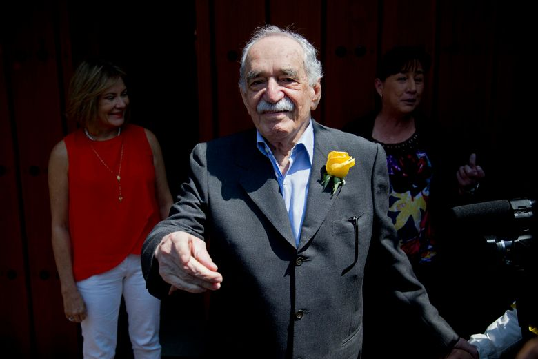 """FILE – In this March 6, 2014 file photo, Gabriel Garcia Marquez greets fans and reporters outside his home on his birthday in Mexico City. Netflix has acquired the rights to Marquez's """"One Hundred Years of Solitude,"""" one of the most celebrated novels of the 20th century. The streaming company announced Wednesday, March 6, 2019 that it will adapt the 1967 book into a Spanish language series. (AP Photo/Eduardo Verdugo, File)"""