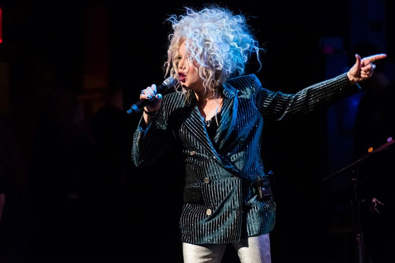 """FILE – In this Dec. 8, 2018 file photo, Cyndi Lauper performs at the 8th annual """"Home for the Holidays"""" benefit concert at the Beacon Theatre in New York. A university in Vermont has announced Lauper will return to the school to give its commencement address.  Northern Vermont University-Johnson said Lauper will deliver the address May 18, 2019.  (Photo by Charles Sykes/Invision/AP, File)"""