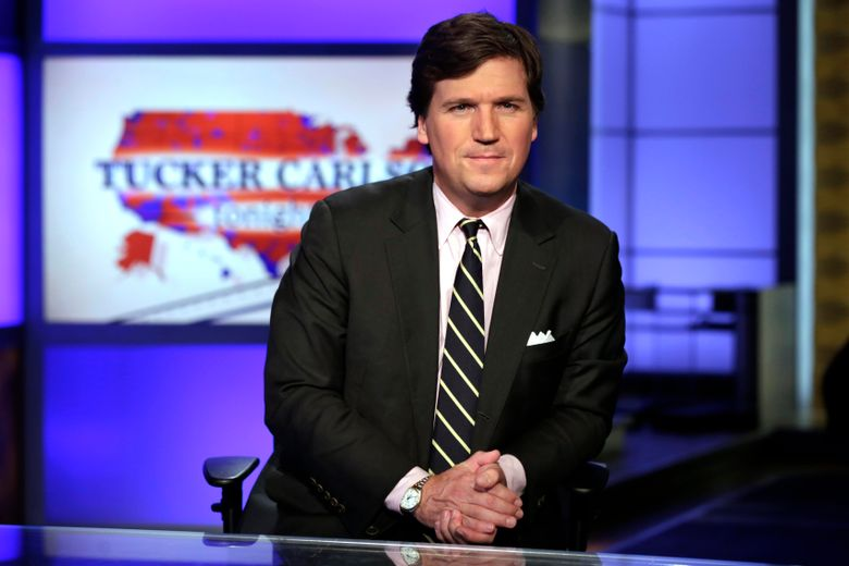 """FILE – In this March 2, 2017 file photo, Tucker Carlson, host of """"Tucker Carlson Tonight,"""" poses for photos in a Fox News Channel studio, in New York. Carlson said Wednesday, March 13, 2019, he's scuttling plans for a TV studio near his vacation home in rural Maine. (AP Photo/Richard Drew, File)"""