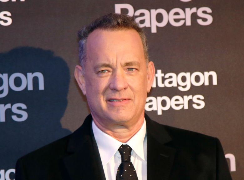 FILE – In this Jan. 13, 2018, file photo, Actor Tom Hanks poses for photographers on arrival at the French premiere of the film 'The Post' in Paris, France. Hanks recently surprised a New Mexico woman celebrating her birthday at an Albuquerque, N.M., restaurant by singing 'Happy Birthday' to her. (AP Photo/Michel Euler,File)