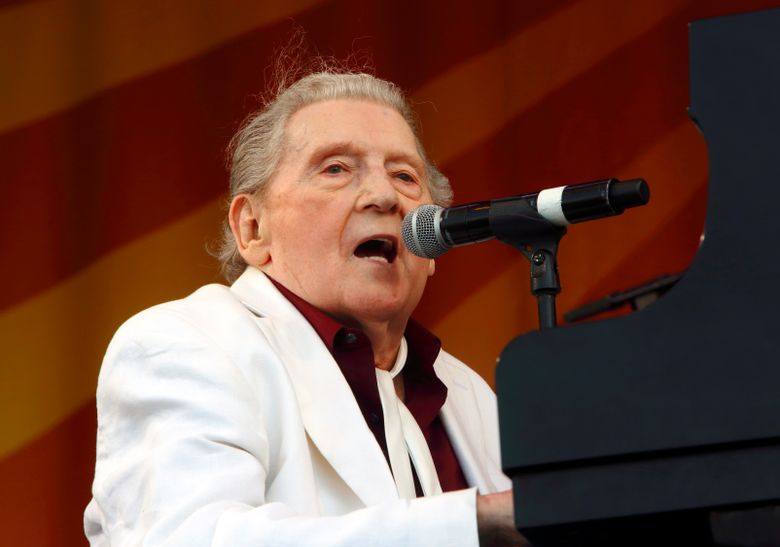 FILE – In this May 2, 2015 file photo, Jerry Lee Lewis performs at the New Orleans Jazz & Heritage Festival in New Orleans. Rock 'n' roll pioneer Lewis is recovering after a minor stroke, but he's expected to make a full recovery. A statement from his publicist says the 83-year-old Rock & Roll Hall of Famer had the stroke Thursday night, Feb. 28, 2019, and is recuperating in Memphis.  (Photo by John Davisson/Invision/AP, File)