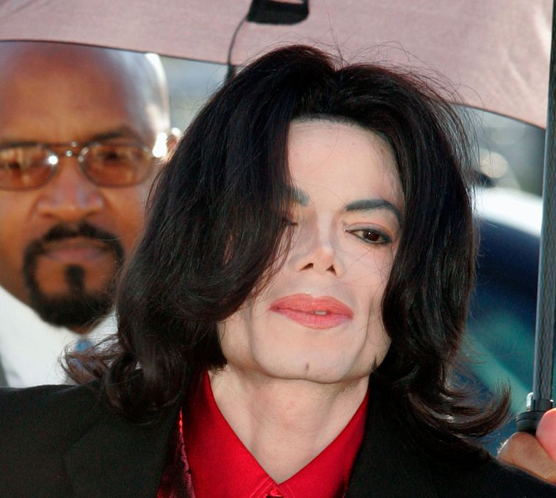 FILE – In this Feb. 23, 2005 file photo, Michael Jackson arrives at Santa Barbara County Superior Court in Santa Maria, Calif. Three major Montreal radio stations have stopped playing Michael Jackson songs as a result of child-molestation allegations against the late musician that aired Sunday, March 3, 2019 in an HBO documentary. A spokeswoman for the owner of the French-language stations CKOI and Rythme and the English-language The Beat said this week they pulled Jackson's music Monday morning. (AP Photo/Carlo Allegri, pool, file)