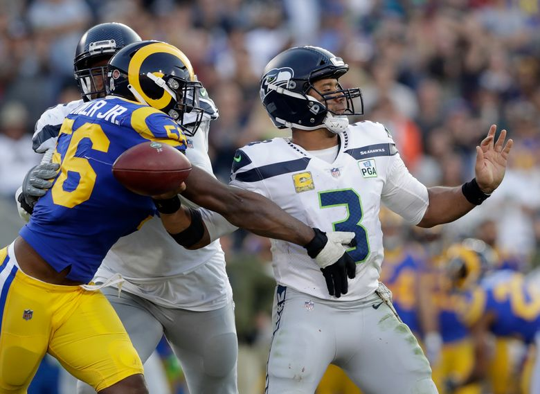 File-This Nv. 11, 2018, file photo shows Los Angeles Rams defensive end Dante Fowler forcing a fumble by Seattle Seahawks quarterback Russell Wilson during the second half in an NFL football game in Los Angeles.  (AP Photo/Alex Gallardo, File)