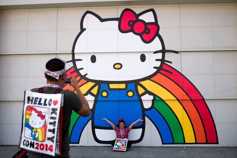 FILE – In this Oct. 30, 2014, file photo, Keith Nunez, left, takes pictures of his wife, Carolina, at the first-ever Hello Kitty fan convention, Hello Kitty Con, at the Geffen Contemporary at MOCA in Los Angeles. Hello Kitty might not have a mouth but she's got a movie deal. Warner Bros.'s New Line Cinema announced Tuesday, March 5, 2019, that it has acquired film rights to Hello Kitty from the Japanese corporation Sanrio. (AP Photo/Jae C. Hong, File)