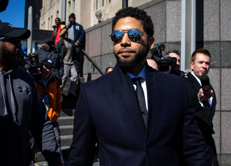 FILE – In this March 26, 2019, file photo, Actor Jussie Smollett leaves the Leighton Criminal Courthouse in Chicago after prosecutors dropped all charges against him. Smollett was indicted on 16 felony counts related to making a false report that he was attacked by two men who shouted racial and homophobic slurs. (Ashlee Rezin/Chicago Sun-Times via AP, File)