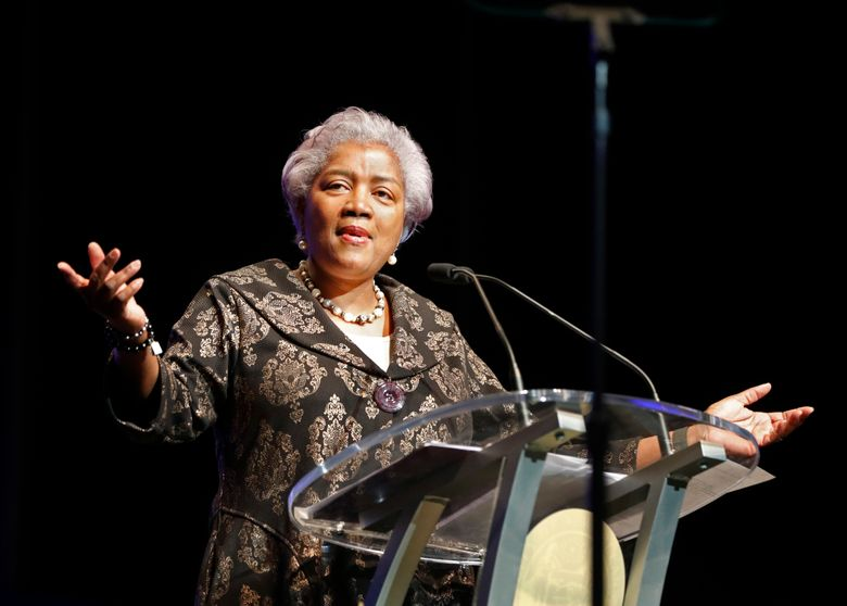 FILE – This May 7, 2018 file photo shows Donna Brazile speaking at the inauguration of New Orleans Mayor Latoya Cantrell in New Orleans. Fox News says it has hired former Democratic National Committee chief Brazile as a political commentator. She had been let go from a similar role at CNN in 2016 after it was revealed that she had shared material about topics that would be addressed at a Democratic forum with Hillary Clinton's campaign. (AP Photo/Gerald Herbert, File)