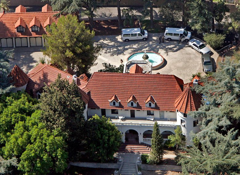 """FILE – This Aug. 9, 2007 file photo shows music producer Phil Spector's mansion on Grand View Drive in Alhambra, Calif. The hilltop Los Angeles-area mansion where Spector killed actress Lana Clarkson in 2003 is for sale at $5.5 million. The chateau known as """"Pyrenees Castle"""" sits on 2.5 acres (1 hectare) in Alhambra. Spector is serving 19 years to life after his murder conviction in Clarkson's death, found shot to death in the foyer of the 8,700-square-foot (808-square-meter) home. (AP Photo/Richard Hartog, Pool, File)"""