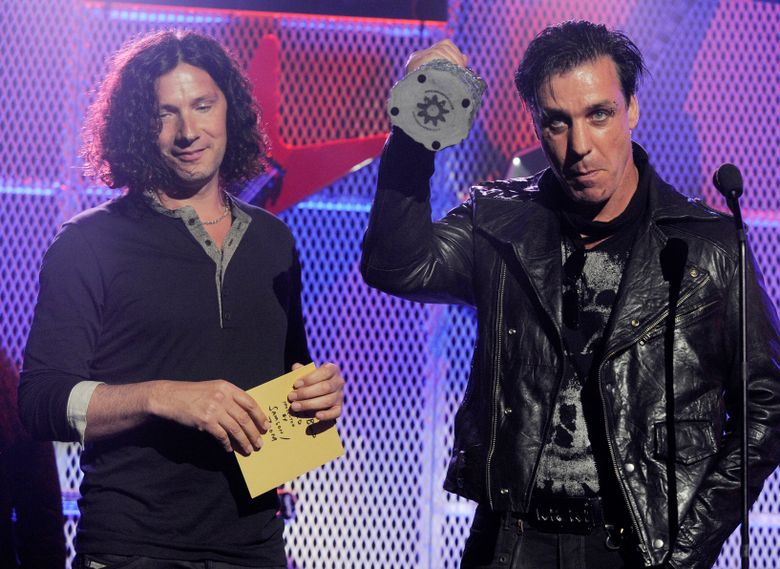 FILE – In this file photo dated Tuesday, April 20, 2011, members of German hard rock band Rammstein, with Till Lindemann, right, and Christoph Schneider accept the award for Best Live Band at the 3rd Annual Revolver Golden Gods Awards ceremony in Los Angeles, USA.  Jewish groups and the Israeli government on Thursday March 28, 2019, criticized Rammstein for a video promoting the release of its new single that features band members dressed as concentration camp inmates standing on a gallows.(AP Photo/Chris Pizzello, FILE)