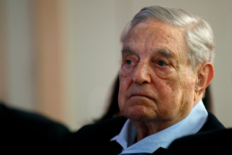 """FILE- In this May 29, 2018, file photo George Soros, Founder and Chairman of the Open Society Foundations listens to the conference after his speech entitled """"How to save the European Union"""" as he attends the European Council On Foreign Relations Annual Council Meeting in Paris. Soros' next book will be a summation of his core beliefs. PublicAffairs announced Friday, March 8, 2019, that """"In Defense of Open Society"""" will be published Sept. 24. Soros, the billionaire philanthropist and frequent target of conservative and anti-Semitic attacks, will cover everything from human rights to the rule of law to progressive politics. (AP Photo/Francois Mori, File)"""