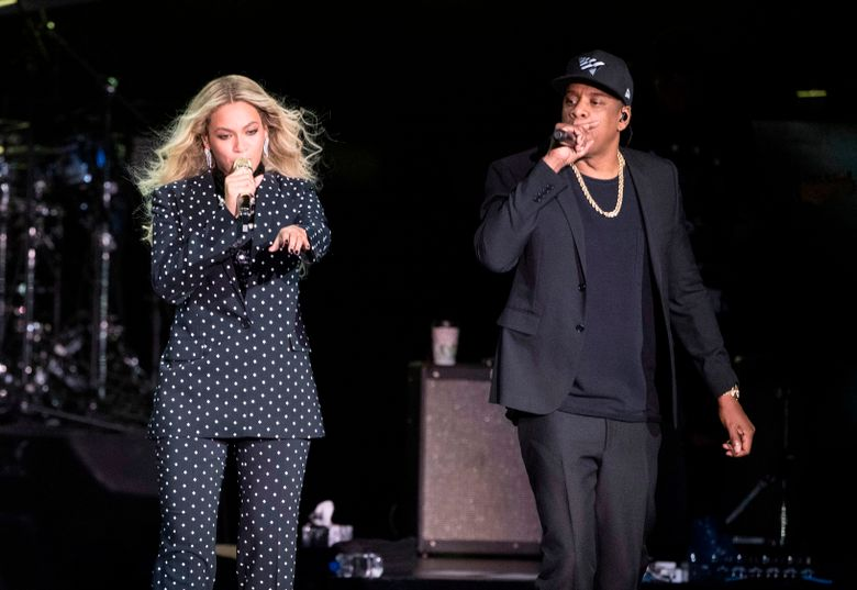 FILE – In this Nov. 4, 2016 file photo, Beyonce and Jay-Z perform during a Democratic presidential candidate Hillary Clinton campaign rally in Cleveland. The pair received the LGBTQ advocacy group's Vanguard Award on Thursday during its 30th annual media awards ceremony in Beverly Hills, Calif. (AP Photo/Matt Rourke, File)