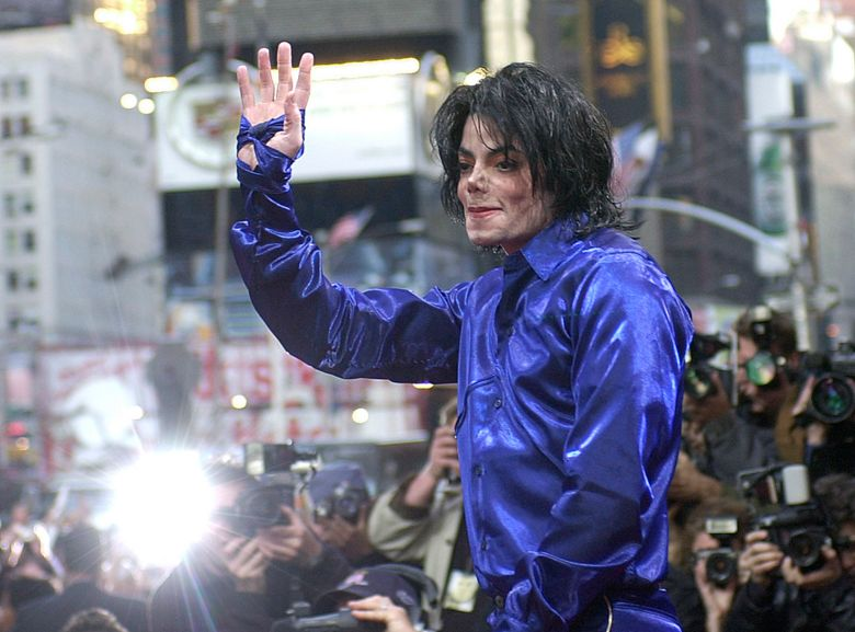 """FILE – This Nov. 7, 2001 file photo, Michael Jackson waves to crowds gathered to see him at his first ever in-store appearance in New York. The producers of """"The Simpsons"""" are removing a classic episode that featured the voice of Michael Jackson. Executive producer James L. Brooks told The Wall Street Journal on Thursday, March 7, 2019,  """"it feels clearly the only choice to make."""" He said fellow executive producers Matt Groening and Al Jean are """"of one mind on this."""" (AP Photo/Suzanne Plunkett)"""