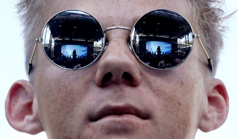 Tyler Fleming watches the band Let's Eat Grandma perform at Bumbershoot last year. The three-day music, comedy and arts festival takes place at Seattle Center. (Alan Berner / The Seattle Times, 2018)
