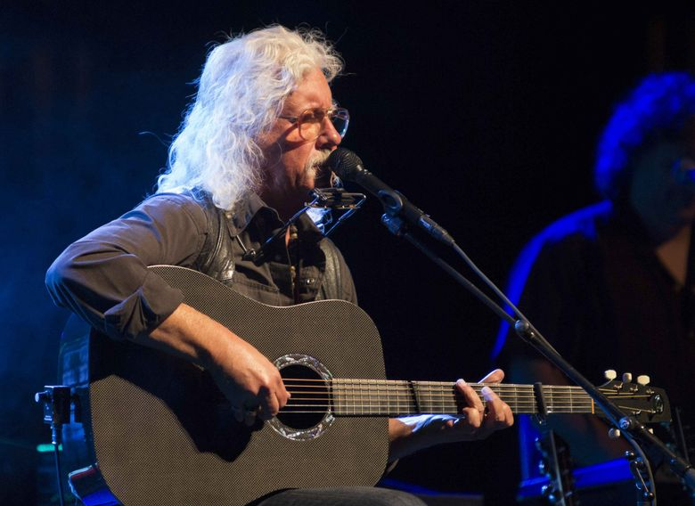 Folk singer Arlo Guthrie is coming to the Moore Theatre on April 30. (Katie Darby / Invision / AP, 2015)