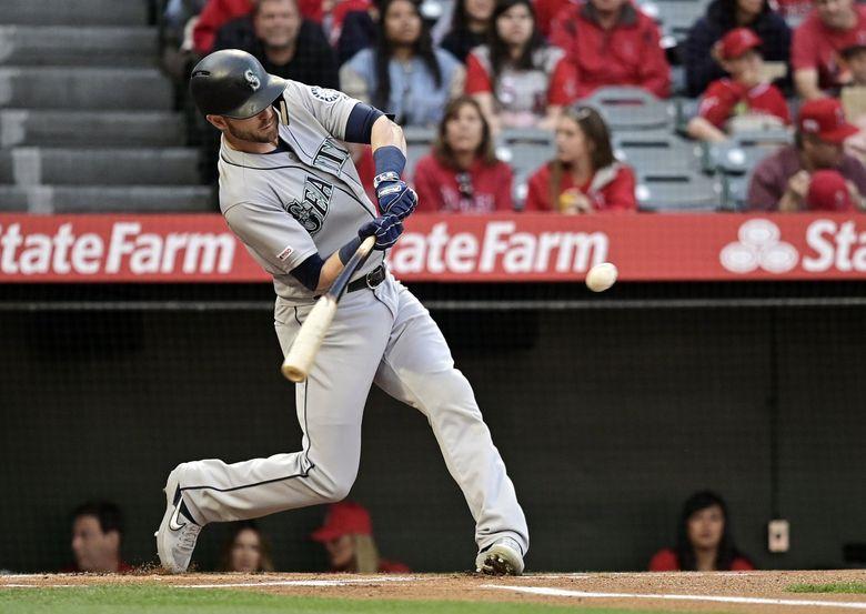 Mitch Haniger hits a solo home run last season.  (Mark J. Terrill / The Associated Press)