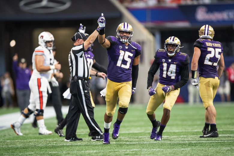 Washington linesbacker D.J. Beavers celebrates a tackle that left Auburn 4th and 10 in the 3rd quarter.   No. 6 Washington played No. 9 Auburn in the Chik-fil-A Kickoff Game at Mercedes-Benz Stadium in Atlanta, GA, Saturday, Sept. 1, 2018. 207632 (Dean Rutz / The Seattle Times)