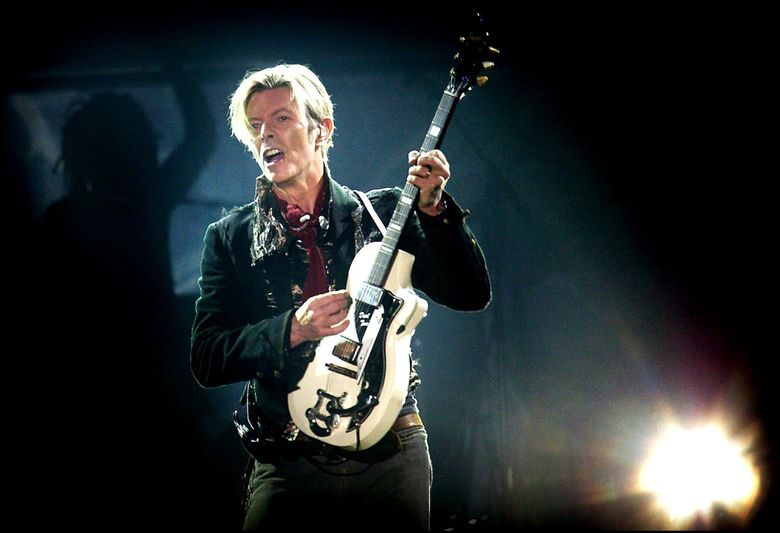"""""""Space Oddity,"""" """"Life on Mars?"""" and other space songs — what can we say,  Bowie really liked space. (Nils Meilvang / The Associated Press, file)"""