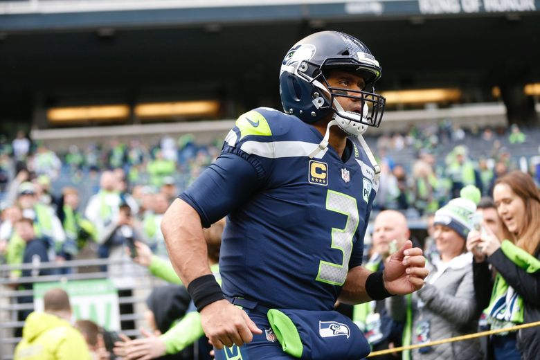 Russell Wilson signed a contract extension as the clock struck midnight Tuesday morning. (Bettina Hansen / The Seattle Times)