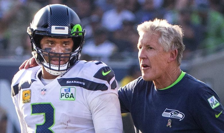 Seahawks coach Pete Carroll encourages quarterback Russell Wilson during a game against the Rams in November 2018. (Mike Siegel / The Seattle Times)