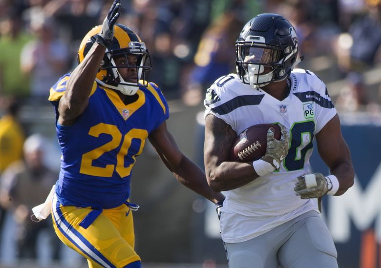 Seahawks running back Rashaad Penny is caught by Los Angeles Rams free safety Lamarcus Joyner in a game in November 2018.  (Mike Siegel / The Seattle Times)