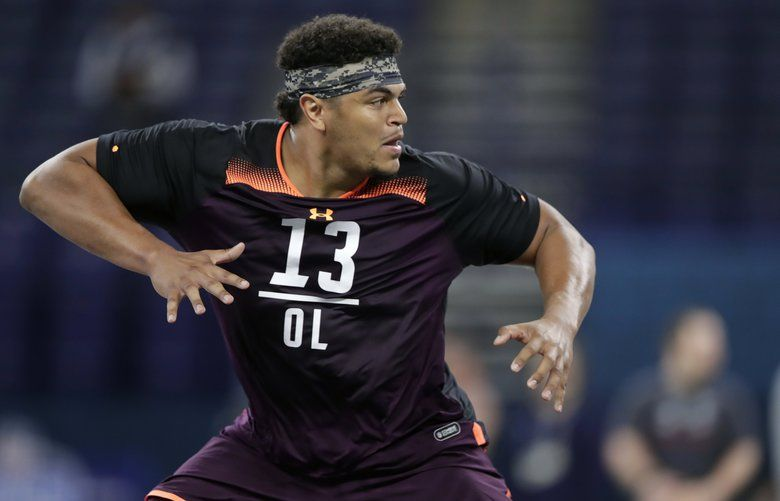 FILE – In this March 1, 2019, file photo, Washington State offensive lineman Andre Dillard runs a drill at the NFL football scouting combine in Indianapolis. Dillard is a possible pick in the 2019 NFL Draft. (AP Photo/Michael Conroy, File) NYPK245 NYPK245