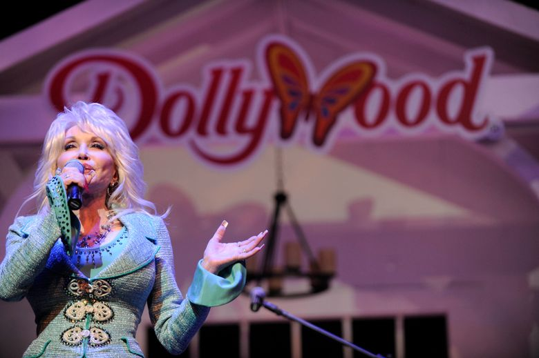 """FILE – In this Aug. 21, 2013 file photo, Dolly Parton speaks during a news conference in Pigeon Forge, Tenn.  Dolly Parton's Dollywood has welcomed a fluffy addition to the amusement park — an eaglet. Media outlets report the eaglet hatched Wednesday, April 17, 2019. A social media post by the park says """"welcome to the world, little eaglet!"""" The Tennessee park says it's """"so excited for this addition to the family."""" (Amy Smotherman Burgess/Knoxville News Sentinel via AP)"""