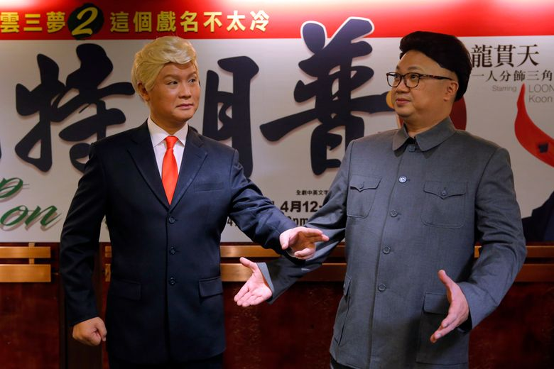 """FILE – In this March 1, 2019, file photo, Hong Kong actors Chan Hung-chun, right, and Lung Koon-tin, dressed as North Korean leader Kim Jong Un and U.S. President Donald Trump, pose during a press conference to promote their upcoming Chinese opera """"Trump on Show"""" in Hong Kong. President Trump is the inspiration for """"Trump on Show,"""" a four-day Cantonese opera that reimagines the president's personal life and his fictional twin brother who lives in China. (AP Photo/Kin Cheung, File)"""