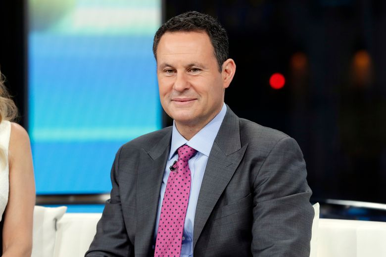 """FILE – This Jan. 17, 2018 file photo shows co-host Brian Kilmeade on the set of """"Fox & Friends"""" in New York. Kilmeade is questioning the loyalty of Minnesota Rep. Ilhan Omar. He said on a segment Wednesday about the freshman Democrat that """"you have to wonder if she's an American first."""" The morning show was doing a segment about a speech the Democrat gave recently about the treatment many Muslim-Americans faced following the Sept. 11, 2001 terrorist attack. Omar tweeted that Kilmeade's remark was a """"dangerous incitement."""" (AP Photo/Richard Drew, File)"""