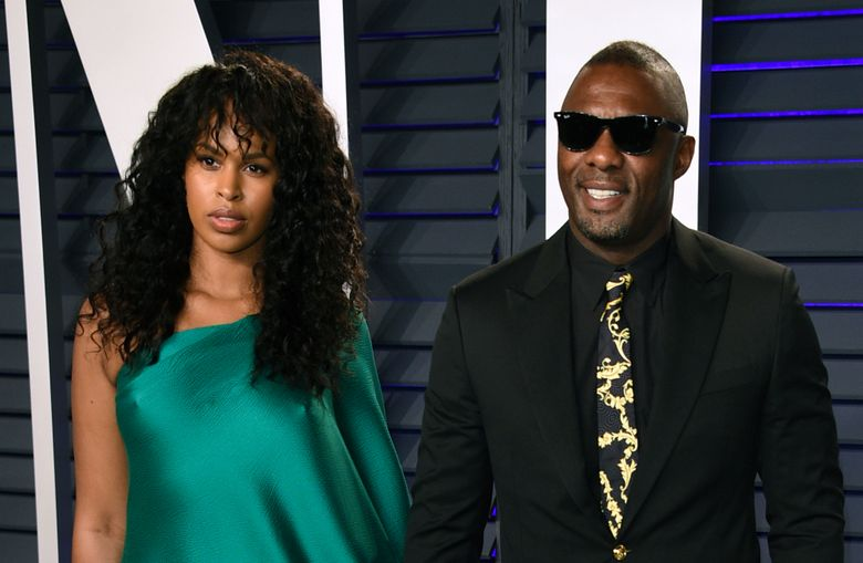 """FILE – In this Sunday, Feb. 24, 2019 file photo, Idris Elba, right, and Sabrina Dhowre arrive at the Vanity Fair Oscar Party in Beverly Hills, Calif. British actor Idris Elba has married model Sabrina Dhowre in Morocco. Images featured by British Vogue on Instagram on Saturday, April 27, 2019 showed the star of """"Luther'' sharing an embrace with Dhowre, a former Miss Vancouver. The magazine says the couple exchanged vows Friday at the Ksar Char Bagh hotel in Marrakesh. (Photo by Evan Agostini/Invision/AP, File)"""