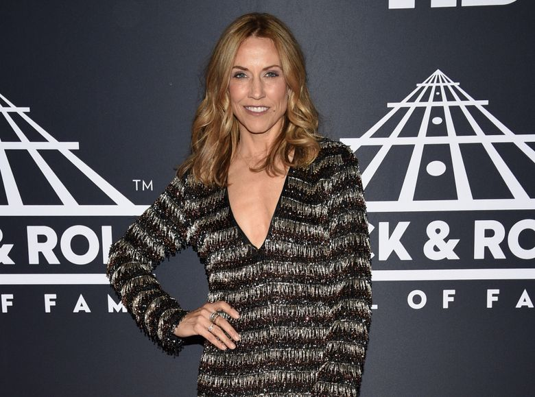"""FILE – This March 29, 2019 file photo shows Sheryl Crow attending the Rock & Roll Hall of Fame induction ceremony in New York.  Crow has released """"Redemption Day,"""" a political and spiritual song about war featuring vocals from the late Johnny Cash that will be featured on what she says is her last album. The song is from her upcoming album for Valory Music Co., which will also include duets with Keith Richards, Stevie Nicks and Eagles members Don Henley and Joe Walsh among others. No release date for the album has been announced. (Photo by Evan Agostini/Invision/AP, File)"""