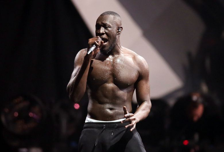 FILE – In this file photo dated Wednesday, Feb. 21, 2018, British grime artist Stormzy performs at the Brit Awards 2018 in London.  The Austrian music Snowbombing festival in Mayrhofen, Austria, is apologizing to Stormzy, who pulled out of an appearance on Wednesday April 10, 2019, after accusing security staff of racial profiling. (Photo by Joel C Ryan/Invision/AP, file)