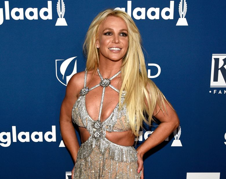"""FILE – In this April 12, 2018 file photo, Britney Spears arrives at the 29th annual GLAAD Media Awards in Beverly Hills, Calif. Spears says though her family has been stressed out lately, she's doing OK. The pop star posted a video to her Instagram on Tuesday, telling her fans: """"All is well. My family has been going through a lot of stress and anxiety lately, so I just needed time to deal."""" Earlier this month, Spears said she decided to focus on self-care as she goes through a rough stretch. In January, she said she was putting her career on hold for the sake of her father, who is sick.  (Photo by Chris Pizzello/Invision/AP, File)"""