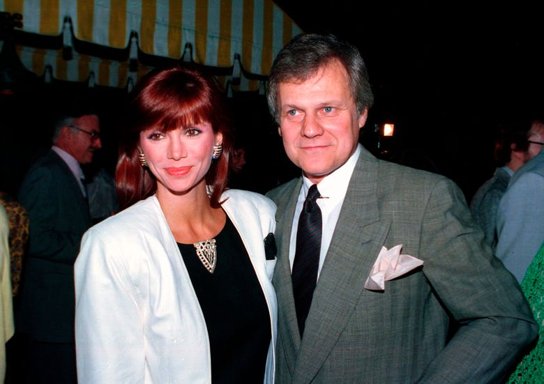 """Ken Kercheval is shown with his """"Dallas"""" co-star Victoria Principal. Kercheval, who played Cliff Barnes on the hit TV series, has died at age 83. Agent Jeff Fisher said Kercheval died Easter Sunday in Clinton, Ind. (AP Photo/Craig Mathew, File)"""