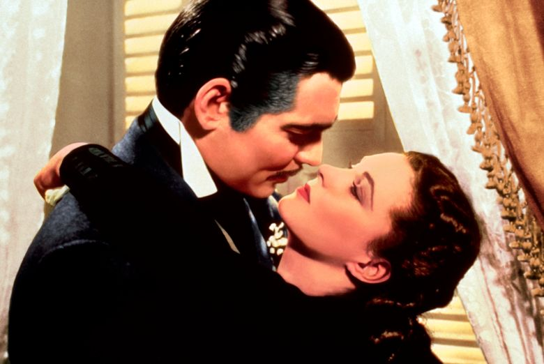 """Clark Gable and Vivien Leigh in a scene from """"Gone with the Wind."""" HBO Max has temporarily removed """"Gone With the Wind"""" from its streaming library in order to add historical context to the 1939 film long criticized for romanticizing slavery and the Civil War-era South. (Turner Classic Movies via AP, file)"""